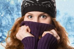 Beautiful  woman dressed in winter clothes smiling - studio shots Stock Photos