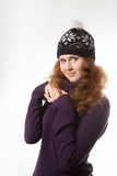 Beautiful  woman dressed in winter clothes smiling - studio shots Royalty Free Stock Photos