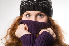 Beautiful  woman dressed in winter clothes smiling - studio shots Royalty Free Stock Images