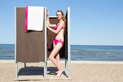 Beautiful woman in dressing cabin on the beach Royalty Free Stock Photos