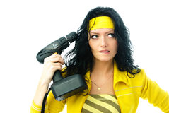 Beautiful woman with a drill Royalty Free Stock Photography