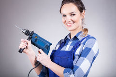 Beautiful woman with drill Stock Photography