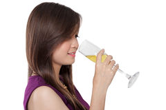 Beautiful woman drink champagne, on white Stock Photography
