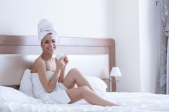 Beautiful woman drink coffee in morning bedroom Stock Photos