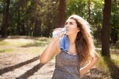 Beautiful woman drink water after sport Stock Image