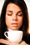 Beautiful woman drinking. Portrait of beautiful woman drinking coffee royalty free stock photo