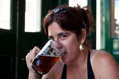 Beautiful woman drinking a beer Royalty Free Stock Image