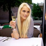 Beautiful woman drinking champagne Stock Photography