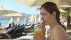 Beautiful woman drinking cocktail stock images