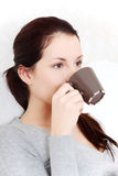 Beautiful woman drinking a coffe / tea. Stock Photography