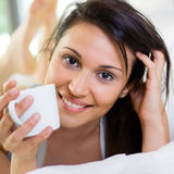 Beautiful woman drinking coffee. At bedroom Royalty Free Stock Photo