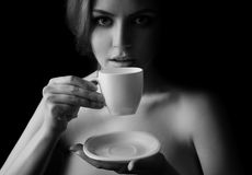 Beautiful Woman Drinking Coffee. BW Image Royalty Free Stock Images