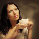 Beautiful woman drinking coffee. Food background Stock Photos