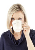 Beautiful Woman is drinking Coffee Royalty Free Stock Photography
