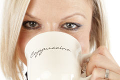 Beautiful Woman is drinking Coffee Royalty Free Stock Images