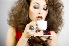Beautiful woman drinking coffee Stock Image