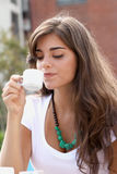 Beautiful woman drinking coffee Royalty Free Stock Image
