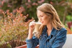 Beautiful woman drinking coffee. One the street stock photos