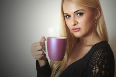 Beautiful woman drinking Coffee.Blond Girl with Cup of tea Stock Photos