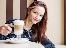 Beautiful woman drinking coffee in a cafe Royalty Free Stock Photo