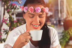 Beautiful woman drinking coffee  in cafe Stock Photography