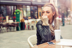 Beautiful woman drinking coffee at the cafe Stock Photo