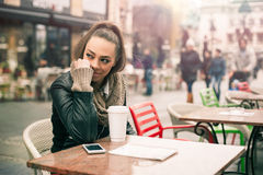 Beautiful woman drinking coffee at the cafe Royalty Free Stock Photo
