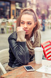 Beautiful woman drinking coffee at the cafe Royalty Free Stock Photography