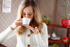Beautiful woman drinking coffee Stock Photos