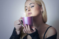 Beautiful woman drinking Coffee. Cup of tea.Delicious Stock Photos