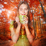 Beautiful woman drinking coffee and dreaming Stock Image
