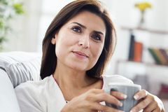 Beautiful woman drinking coffee at home. Beautiful woman drinking  coffee at home Stock Photo