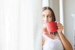 Beautiful woman drinking coffee at home Stock Photos