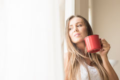 Beautiful woman drinking coffee at home Royalty Free Stock Images