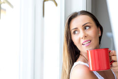 Beautiful woman drinking coffee at home Stock Image