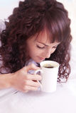 Beautiful woman drinking coffee Stock Photo