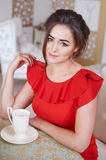 Beautiful woman drinking coffee in the kitchen Royalty Free Stock Photography