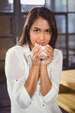 Beautiful woman drinking a coffee and looking away Stock Image