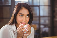 Beautiful woman drinking a coffee and looking away Royalty Free Stock Image