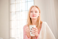 Beautiful woman drinking coffee in the morning Stock Photo