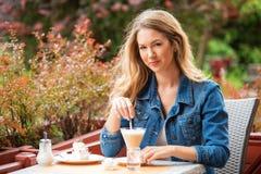 Beautiful woman drinking coffee. One the street stock photo