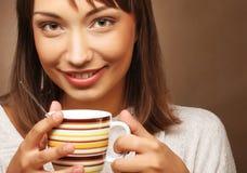 Beautiful woman drinking coffee Royalty Free Stock Photos