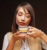 Beautiful woman drinking coffee Royalty Free Stock Image