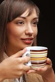Beautiful woman drinking coffee Stock Photography