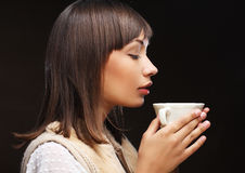Beautiful woman drinking coffee Royalty Free Stock Photo