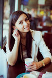 Beautiful Woman Drinking Coffee. And Smiling stock image