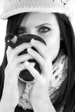 Beautiful woman drinking coffee in winter Stock Image