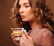 Beautiful woman drinking coffee Stock Image