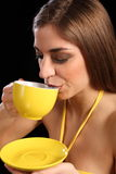 Beautiful woman drinking cup of black tea Stock Photography