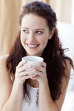 Beautiful woman drinking a cup of coffee in bed stock photos